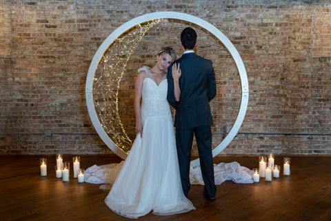 Groom with Bride in a tulle and sparkling wedding dress