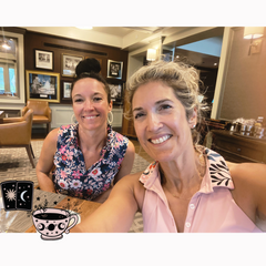 two women drinking coffee in a golf club house