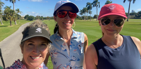Three Women On A Golf Trip In Miami in Golf Polos and Hats