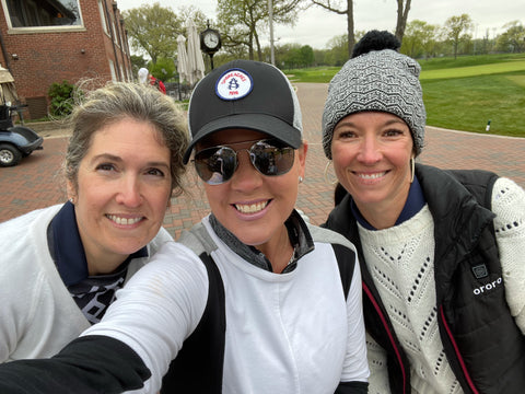 Three Women on Golf Course in Sweaters and Hats