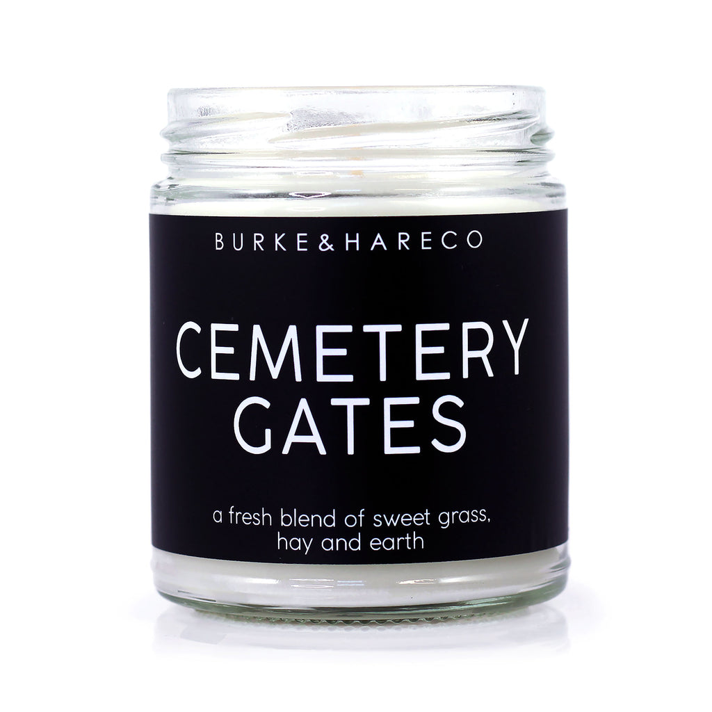 Goth candle with black label that says Cemetery Gates Minimalism Unique Candle