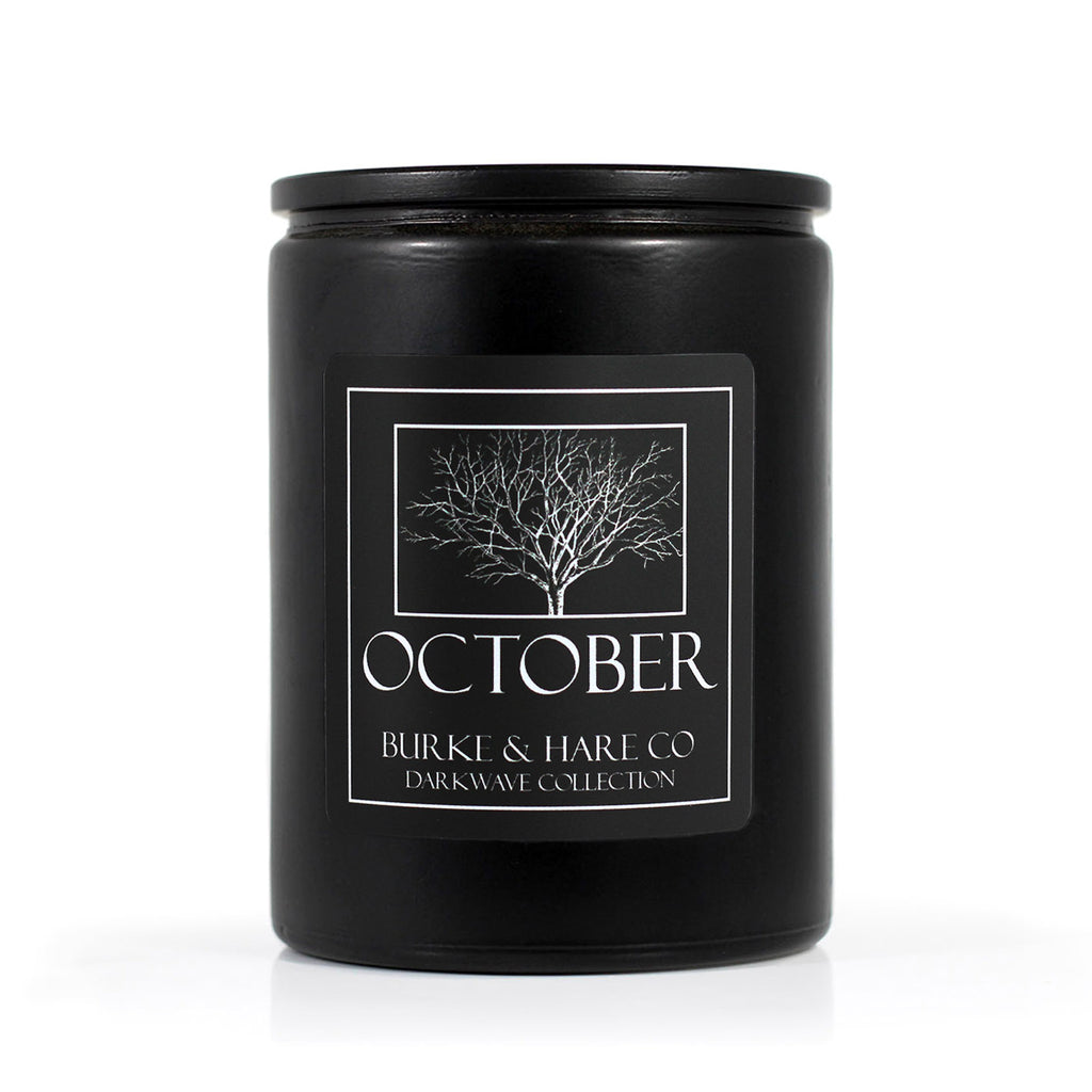 Halloween candle. Black Goth candles with spooky tree design on label