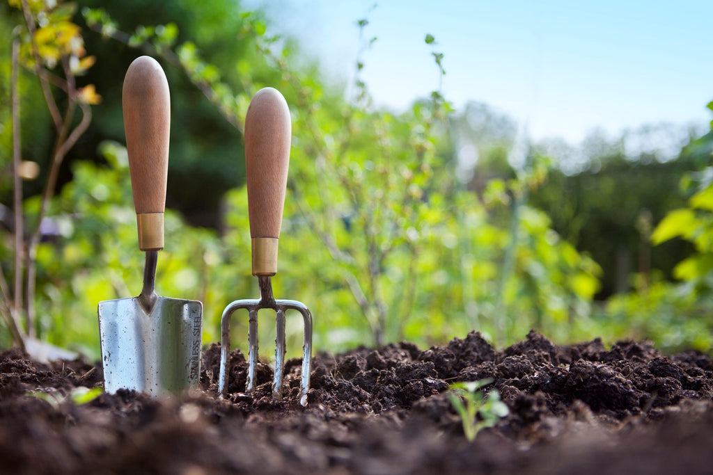 Gardening tools in compost
