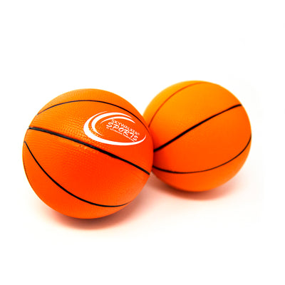 Two orange foam basketballs that have the Skywalker Sports logo on it.