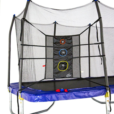 Triple Toss Game is tied to the enclosure poles of rectangle trampoline. Red and blue bean bags sit on trampoline spring pad.
