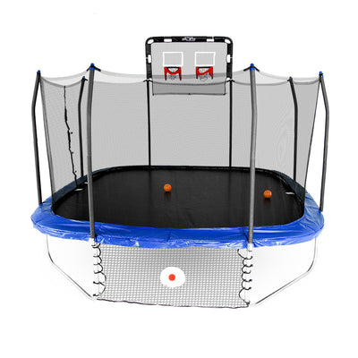Square trampoline with blue spring pad, double basketball hoop attached to top of enclosure poles, and Kickback game attached below the frame. Two orange basketballs lay on the jump mat.