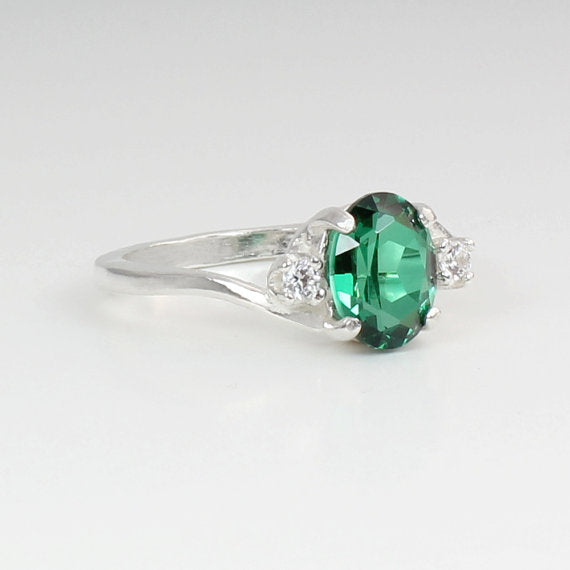Emerald and Diamond Accents Sterling Silver Ring / Oval-Shaped