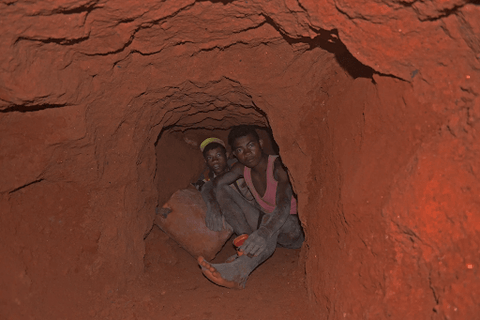 two young miners with no safety wear in a mine
