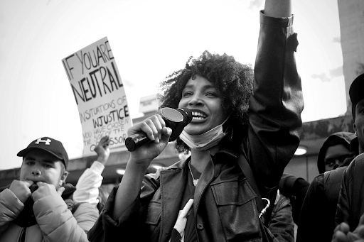 woman talking at protest