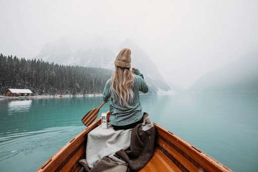 woman on lake in boat