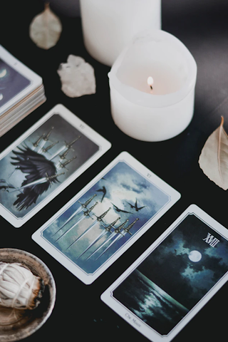 tarot deck spread with candles