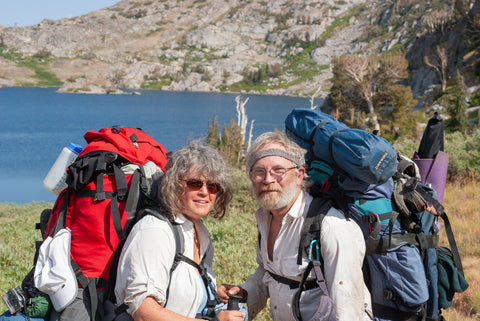 Portrait of Rob badger and Nita Winter back packing at Lake Winnemucca in Sierra Nevada Mountains, California