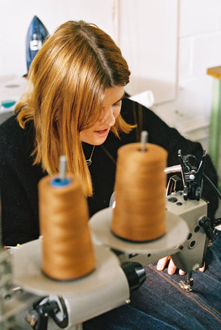 Close-up of Siobhan working hard at the sewing machine