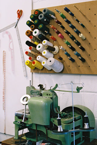 A pinboard full of thread and habedashery and our highly coveted Reece 101 Buttonhole Machine