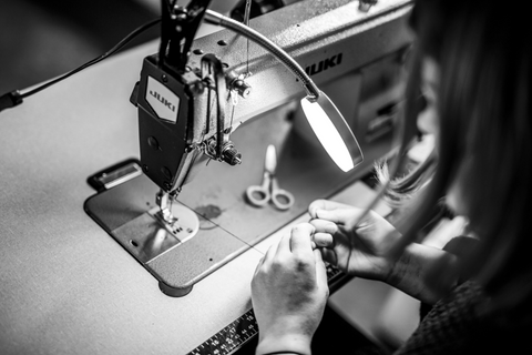 close up of Siobhan sewing some reclaimed denim