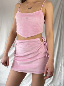 Model shows front view of pink velour crop top