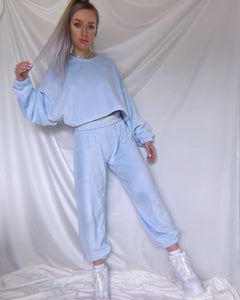 Model stood up showing front view of Borderline Tacky Bubblegum Blue Fluffy Joggers
