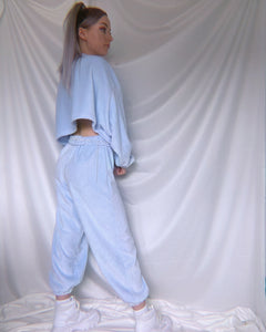Model stood up showing back view of Borderline Tacky Bubblegum Blue Fluffy Joggers