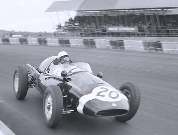Stirling Moss cornering Silverstone Smith & Co Galleries - Strivezy