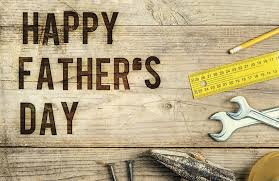 "Editorial Image of a wooden sign that says ""Happy Fathers Day"""