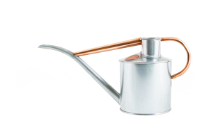 Steel watering can with copper details