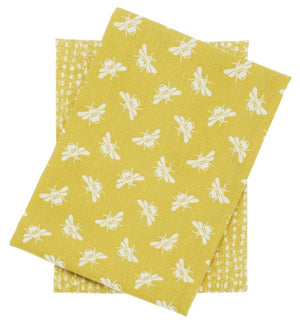 Two yellow and white printed bee tea towels