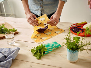 Wrapping food in beeswax wrap.