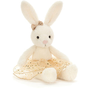 Large bunny soft toy wearing a gold tutu