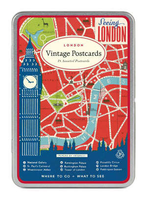 Tin containing vintage London postcards