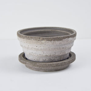 Grey pot with matching saucer