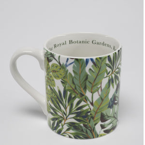 Mug with green tropical leaf pattern