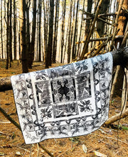luxury, bespoke Elwyn New York silk bandana with black and white, art nouveau, whimsical, storybook print, hanging on a branch in the middle of the woods