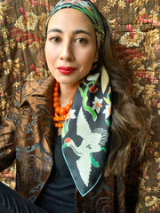Classic woman wearing bespoke Elwyn New York Scarf as a headband with a botanical crane print is collaged together from antique glass and pearl, beaded embroideries of yesteryear.