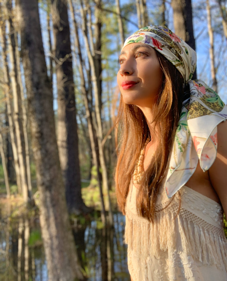Side View of a classic woman in the middle of the woods, wearing a luxury, bespoke Elwyn New York silk scarf on her head with vintage tropical, floral, bamboo, leopard wall paper print
