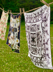luxury, bespoke Elwyn New York silk bandana with black and white, art nouveau, whimsical, storybook print, hanging on a laundry line