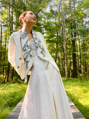 Classic woman in the woods wearing a luxury, bespoke Elwyn New York silk scarf draped around her neck with black and white, art nouveau, whimsical, storybook print