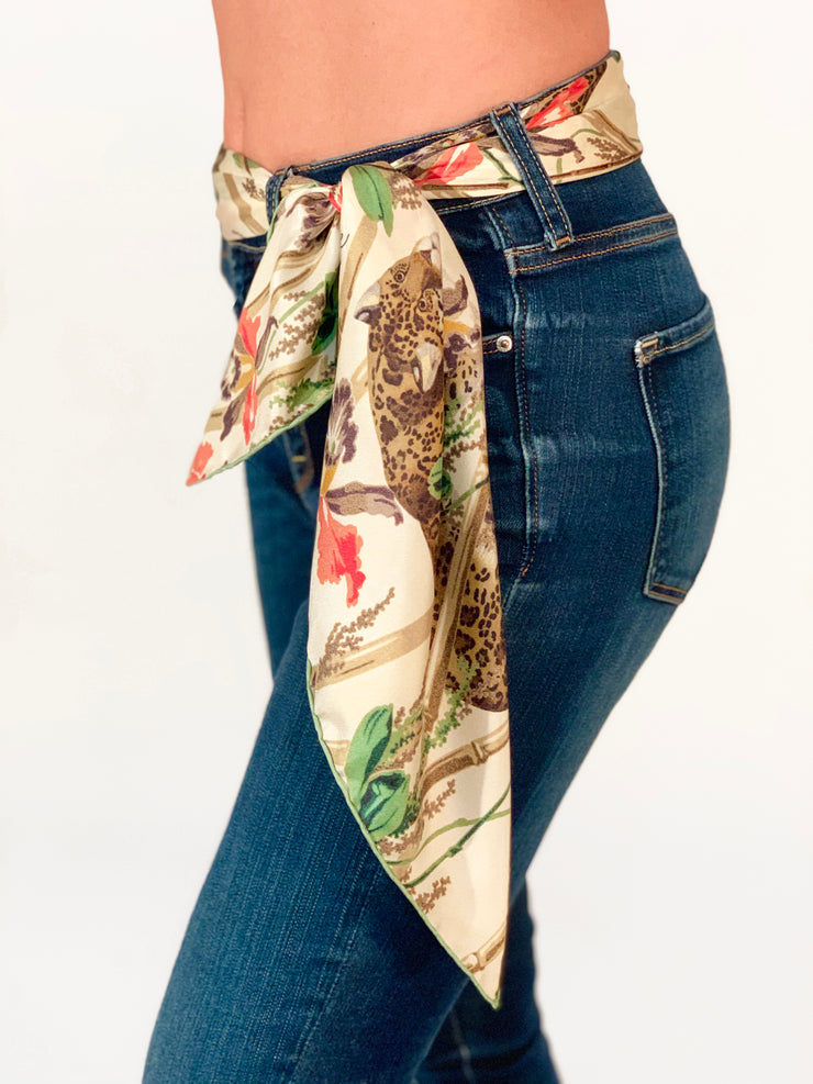 classic woman in jeans wearing a luxury, bespoke Elwyn New York silk scarf as a belt with vintage tropical, floral, bamboo, leopard wall paper print