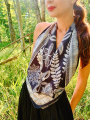 Classic female in the forest, wearing bespoke, luxury, black and white Elwyn New York silk scarf Tied as a halter top with a vintage lace print and graphic fringe border