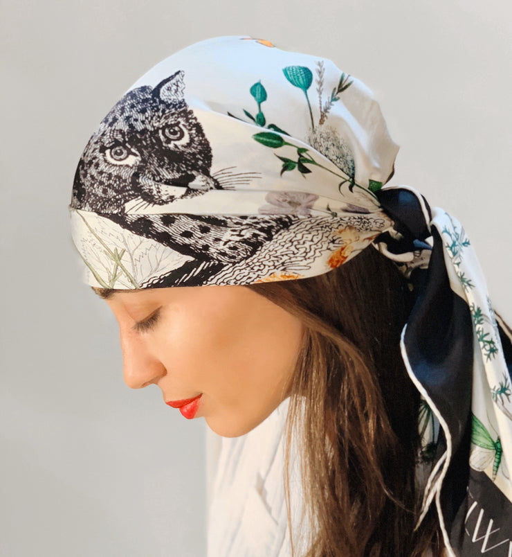 Side view of classic woman wearing a luxury, bespoke Elwyn New York silk scarf on her head  with vintage style, botanical, floral, butterfly and leopard print