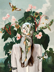 Classic Female standing in a fantastical, lush garden among the butterflies, wearing a luxury, bespoke Elwyn New York silk scarf on her head with a geometric butterfly vintage modern style print