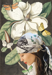 classic female surrounded by a fantastical illustration of flora and butterflies, wearing a luxury, bespoke Elwyn New York silk scarf on her head  with vintage style, botanical, floral, butterfly and leopard print