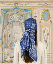 fantasy vintage boudoir illustration of a classic woman wearing a bespoke Elwyn New York Scarf on her head with an ornate, blue and white, vintage-pastoral bandana design. Classic, feminine, and romantic