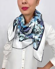 Classic woman wearing a luxury, bespoke Elwyn New York silk scarf around her neck with vintage style print of floral field and modern lazing leopards