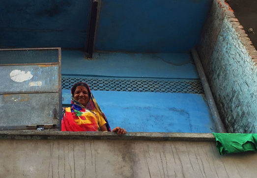 BLUE WALL SMILING WOMAN