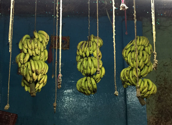 bananas and blue wall