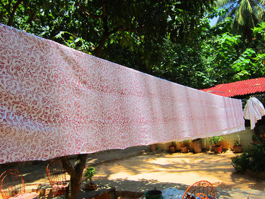 red-floral-design-pillow-case-under-air-drying