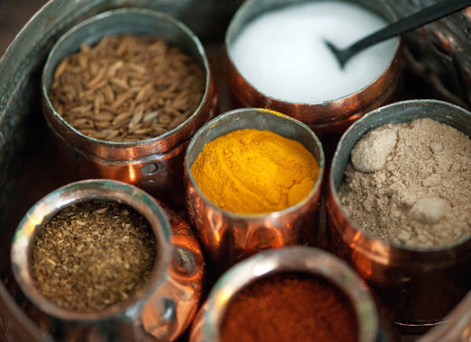 spices in copper containers