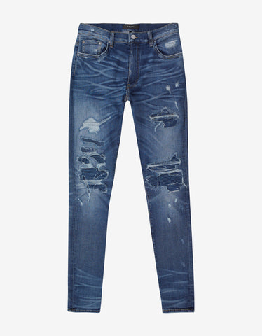 Amiri MX1 Patch Med Indigo Distressed Skinny Jeans