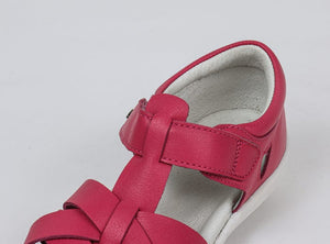 Red Bobux Tropicana Sandals with soft leather and a closed toe design.