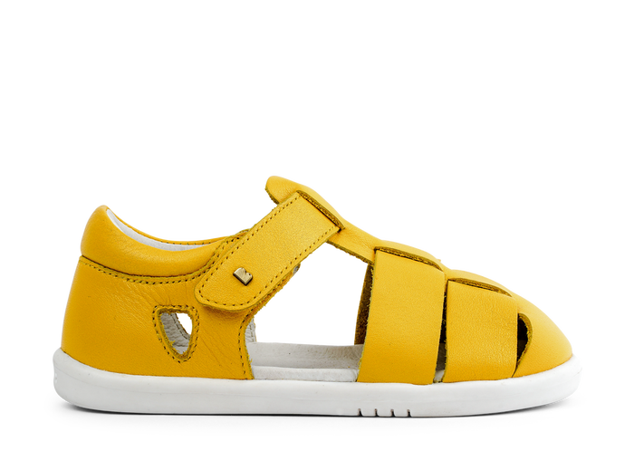 bobux yellow tidal sandals with a closed toe design.